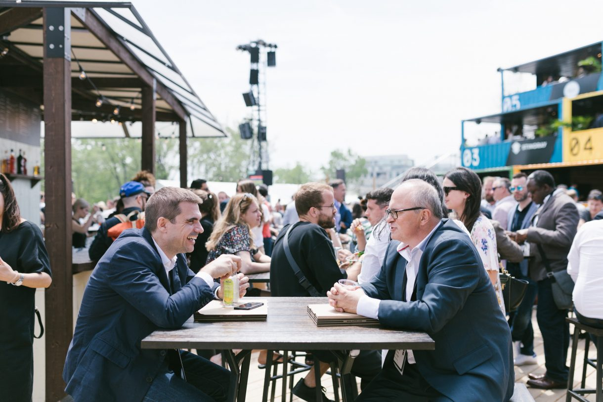 Two businessmen in conversation at C2 Montreal 2019