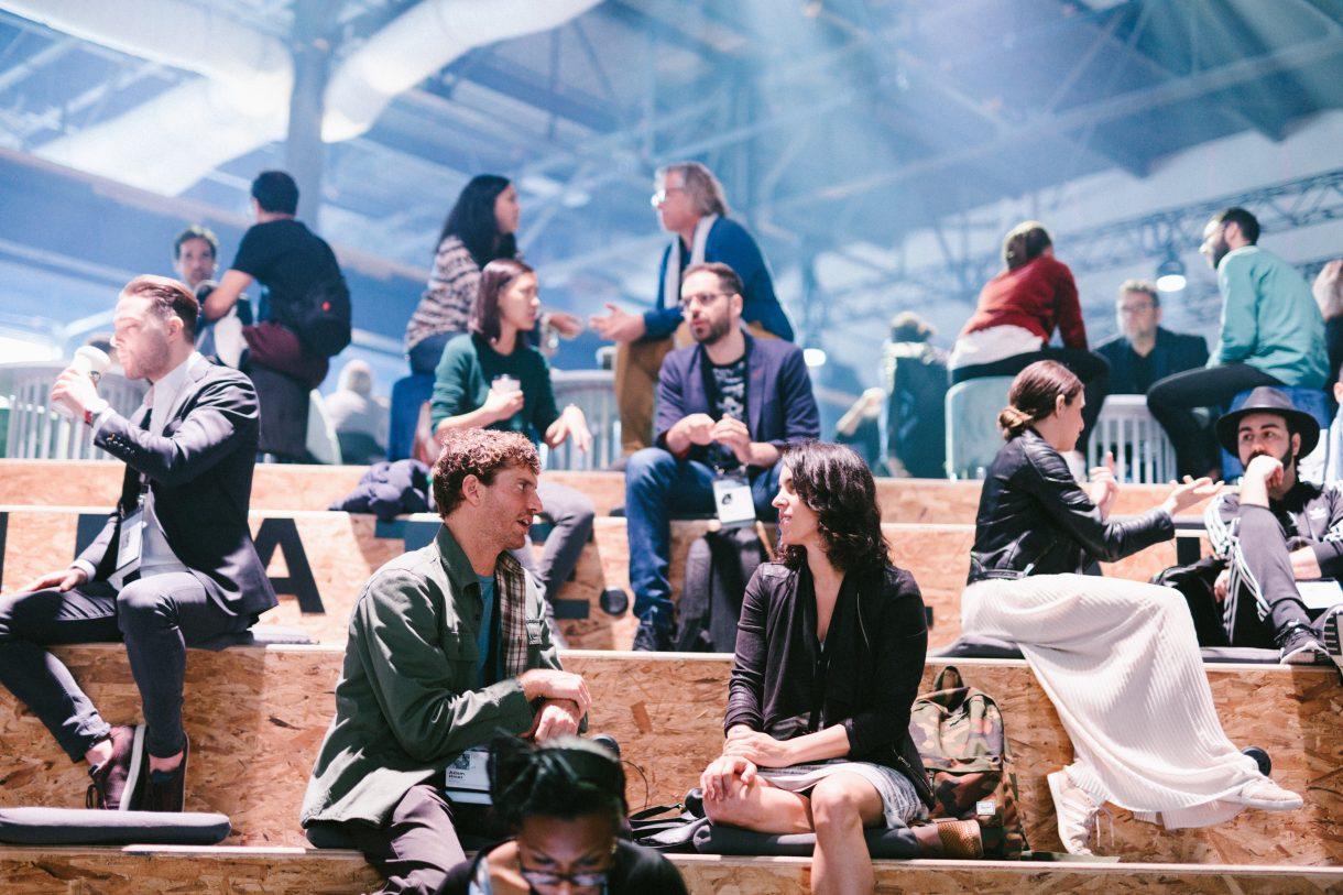 man and woman sitting in the C2 Montreal braindate lounge